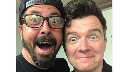 """Watch Foo Fighters troll audience playing """"Never Gonna Give You Up"""" with Rick Astley"""