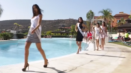 Spanish Miss Universe contestant falls into pool in an attempt to elegantly twirl